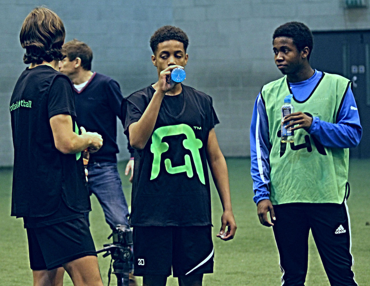 Academy_footballers_take_a_break_from_a_football_training_session