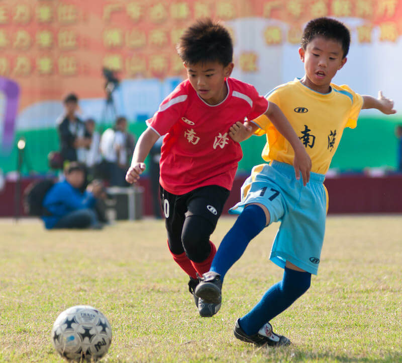 young-asian-footballers-play-football-an-academy-game-football4football