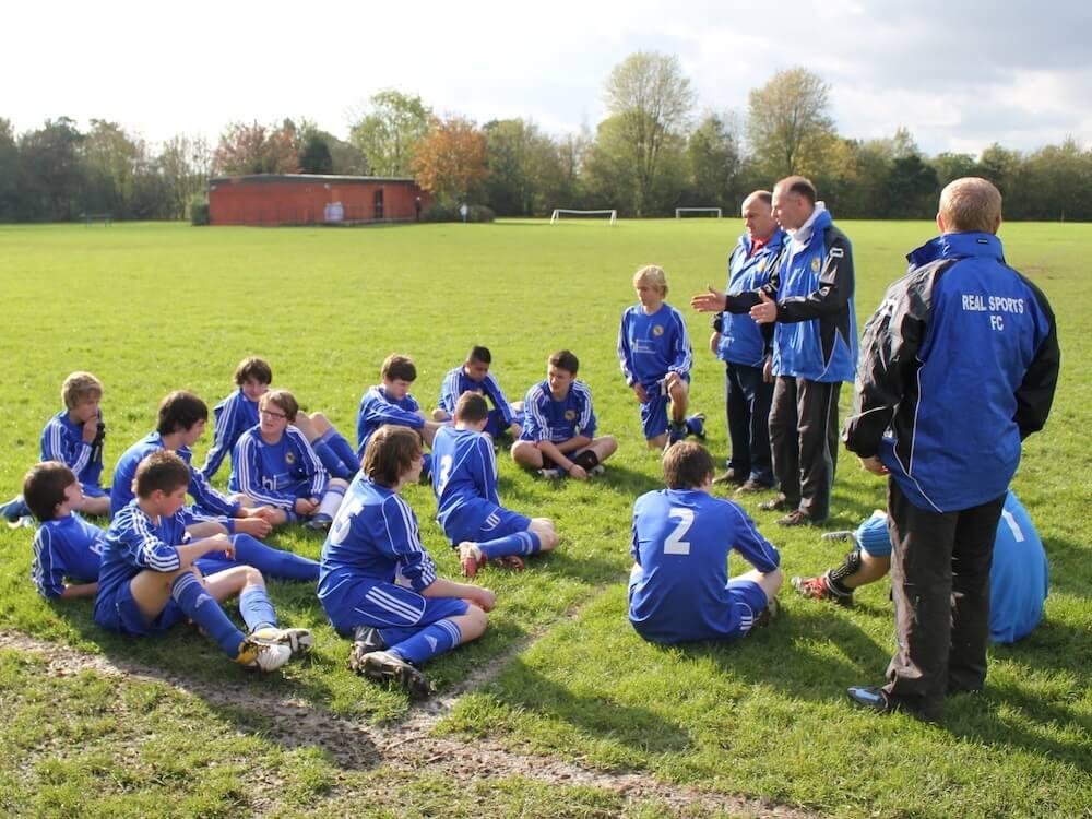 Grassroots_football_coach_gives_a_team_talk_football4football