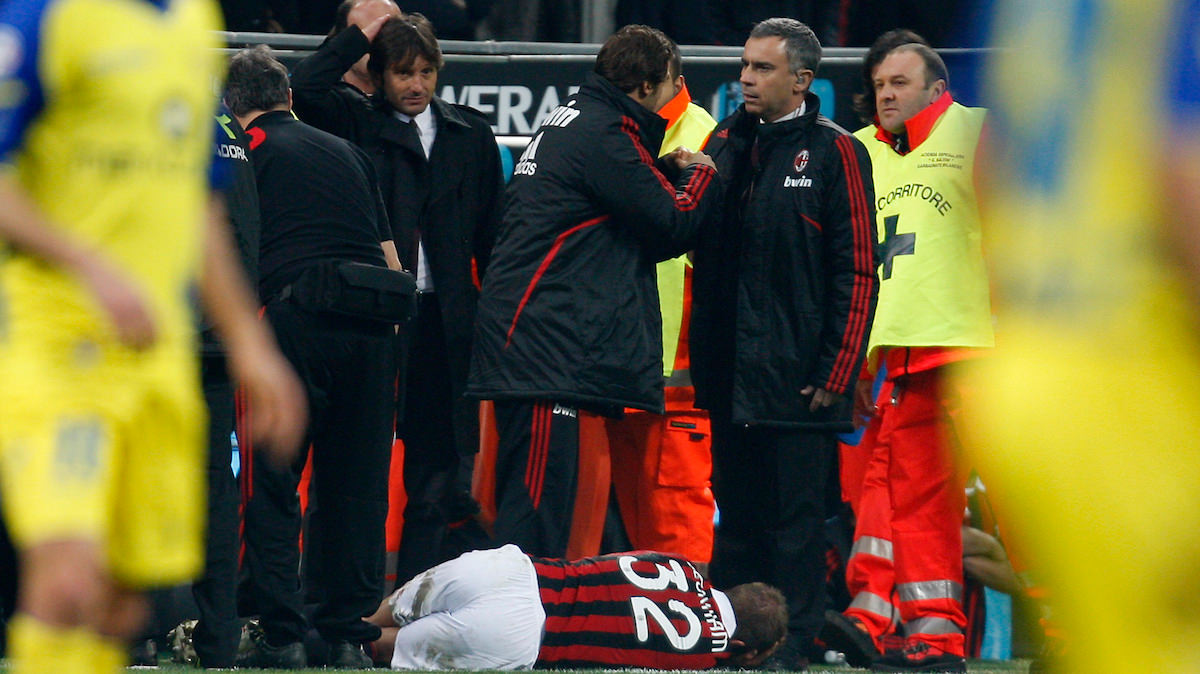 David Beckham lies on the floor in agony after rupturing his Achilles tendon whilst playing for AC Milan.
