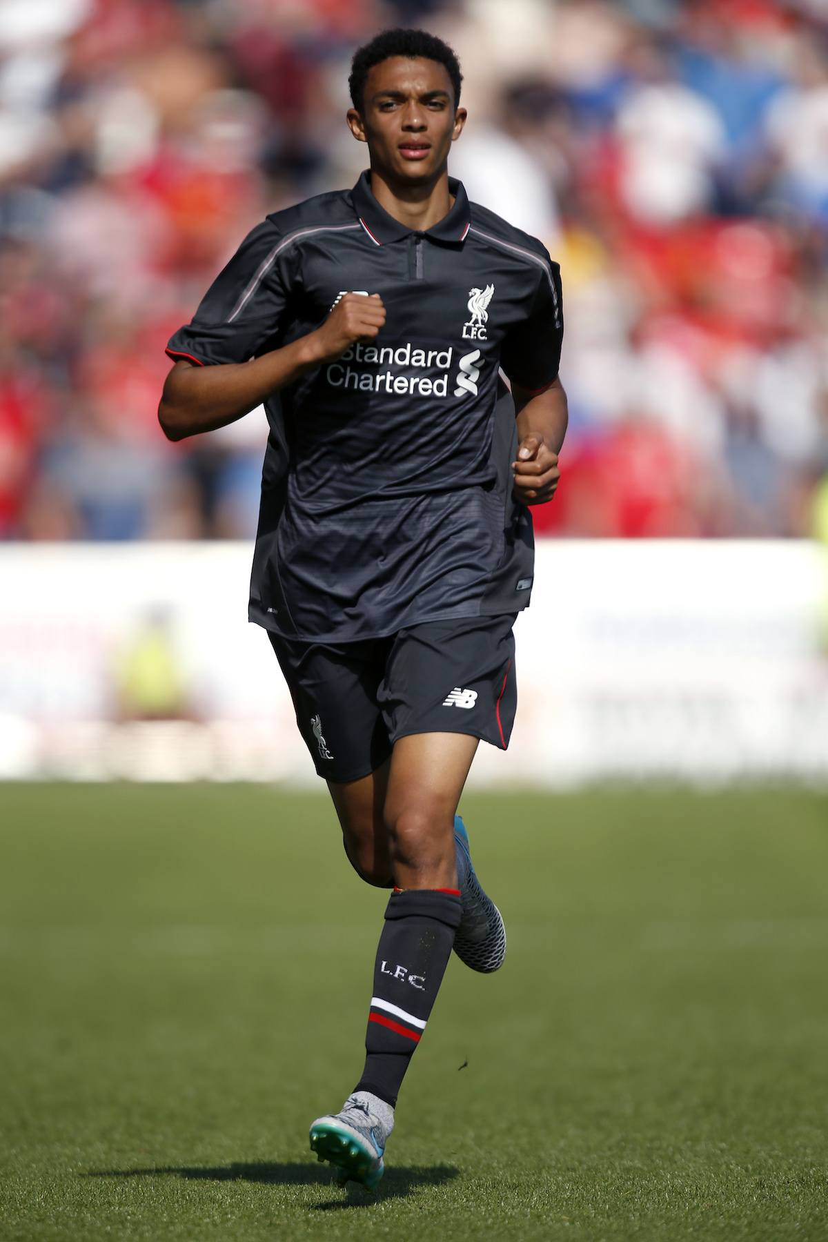 Trent_Alexander_Arnold_strides_out_on_the_pitch_for_Liverpool